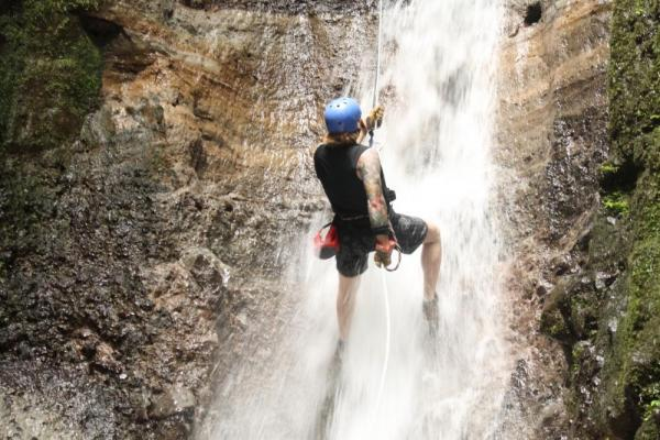 Rapelling waterfalls on the canyoning tour in Arenal
