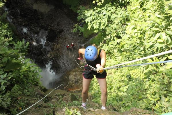 Rappelling waterfalls on a canyoning tour in Arenal