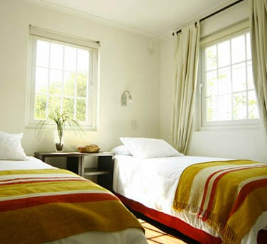 Cheerful sunlit guest rooms
