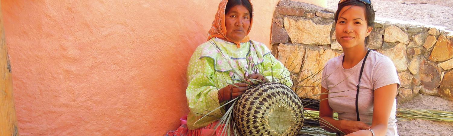 Sitting with a few basket-weavers