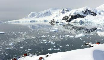 Explore the rugged shores and outposts of Antarctica