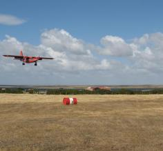 Plane landing near Darwin on East Falkland