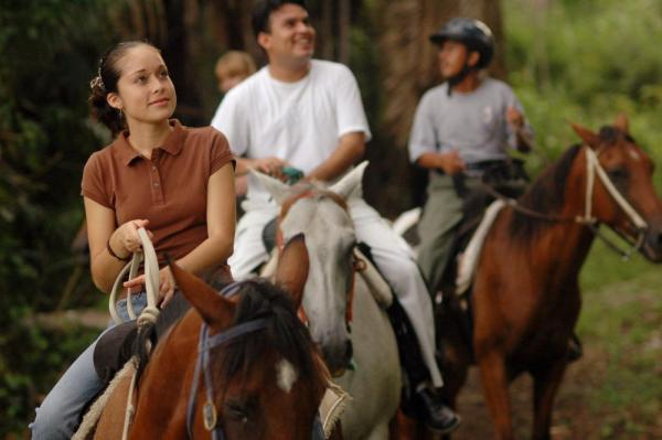 Horseback riding through the rainforest at Chaa Creek