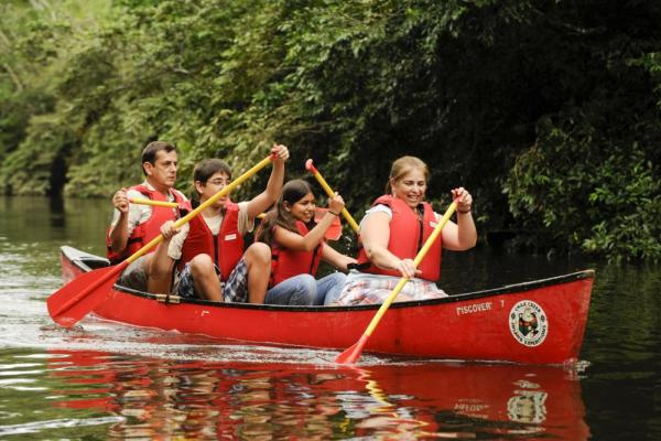 Family canoe trip through the rainforest