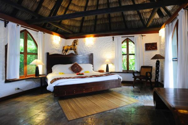 Luxurious bedroom at the Lodge at Chaa Creek