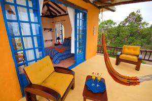 Relax inside or out on your private porch at Mantaraya Lodge