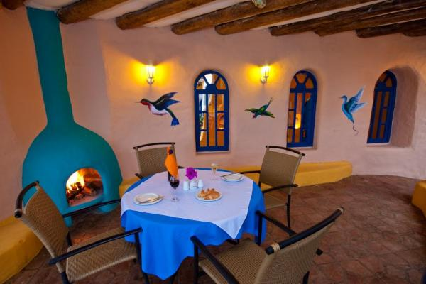 A cozy fireside meal for cold nights at Mantaraya Lodge