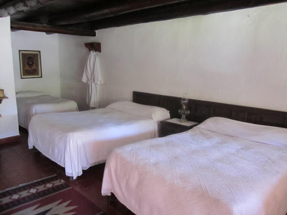 Homespun cotton bedspreads, bathrobes and richly tiled floors offer cozy accommodations