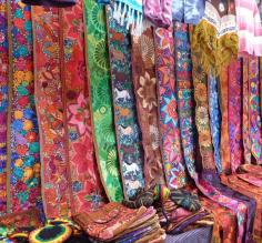 Brightly colored weavings in the market