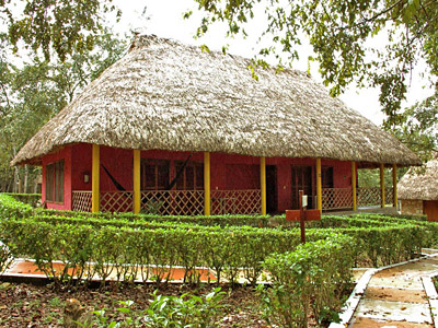 Accommodations are provided in thatched roof cabanas