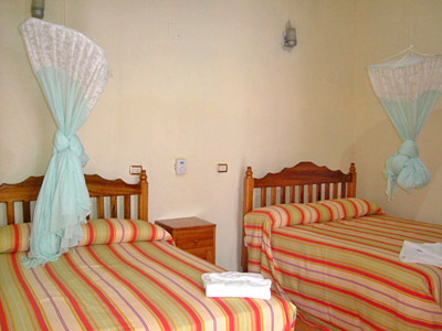 Rooms are equipped with mosquito netting and private bath facilities