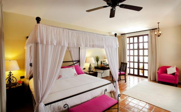 Canopy beds in the Deluxe Room