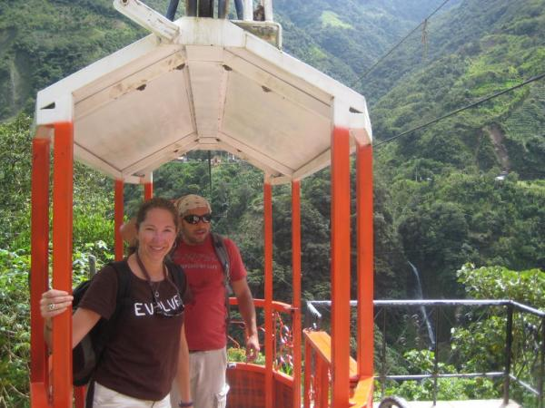 Julie and guide, Daniel, on the cable car in Banos