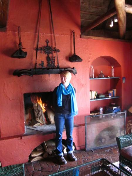 Warming up by the fire at El Porvenir