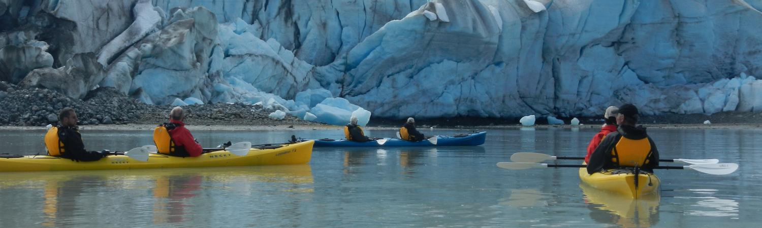 Kayaking close to glaciers