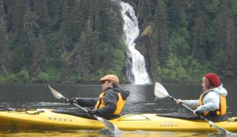 Kayaking past a waterfall