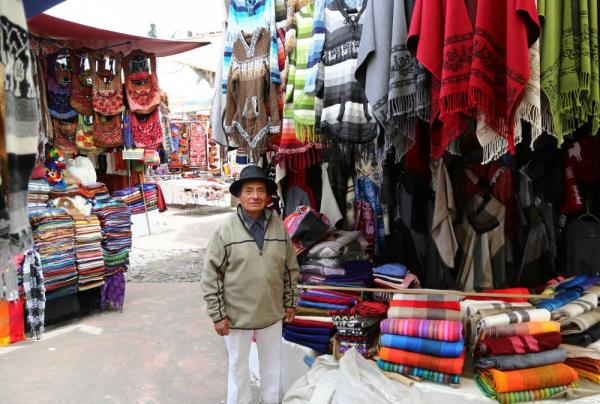A local selling his weavings in the market