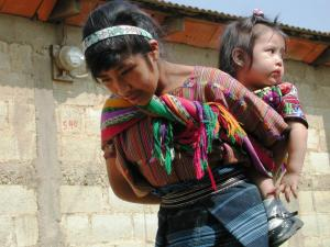 Maya woman carrying her toddler in the Guatemala Highlands
