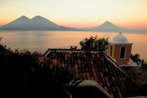 The sun sets behind the volcanoes around Lake Atitlan, Guatemala