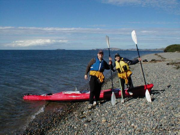 Happy couple during their sea kayak tour around Chiloe Island