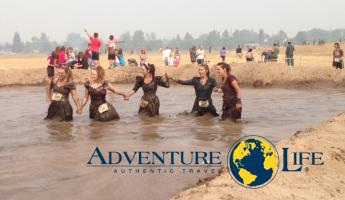 Crossing the finish line through the mud bath!