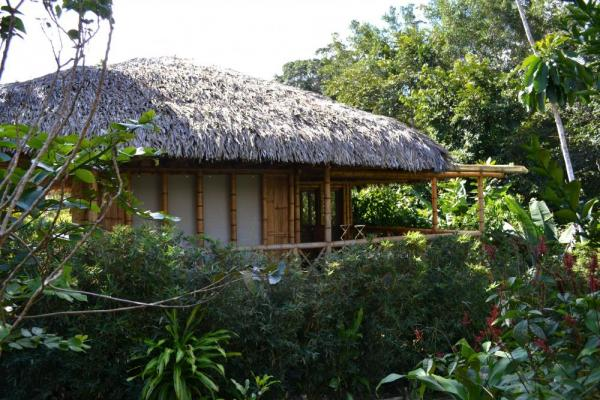 Cabanas are nestled into the native surroundings