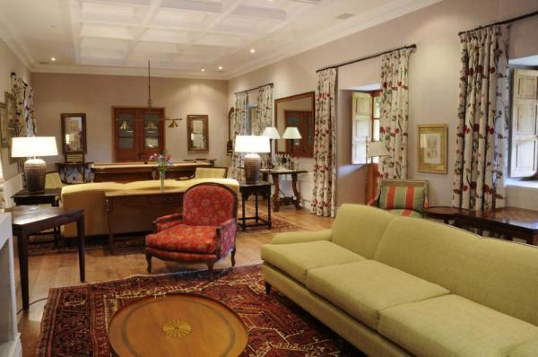 Guests will enjoy lingering in the cozy reading living room with its pool table, chimney and honesty bar