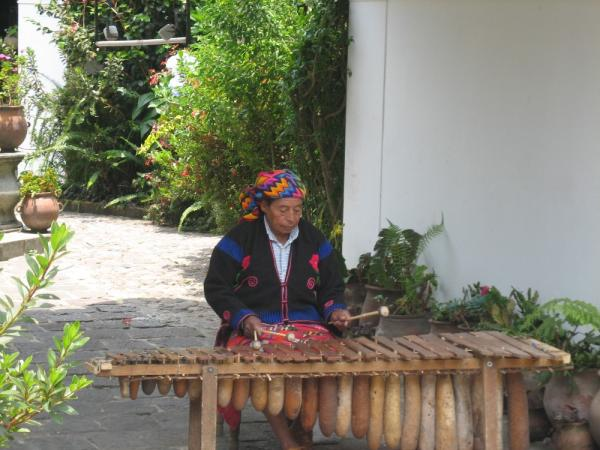 A local plays music in Guatemala