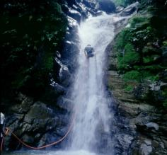 Rapelling upt he waterfall in Costa Rica