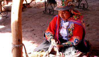 A local woman weaves in the market