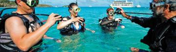 Travelers learning how to scuba dive.