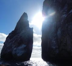Sun shining through Kicker Rock