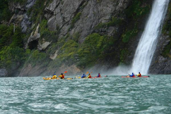 Kayaking under a waterfall in Patagonia