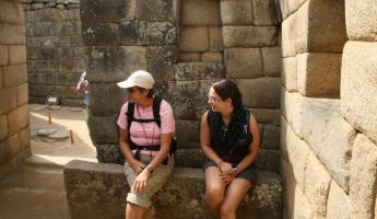 The ladies rest while learning at Machu Picchu