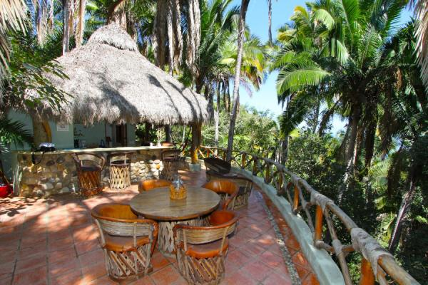 Relax on the deck of your jungle Palapa