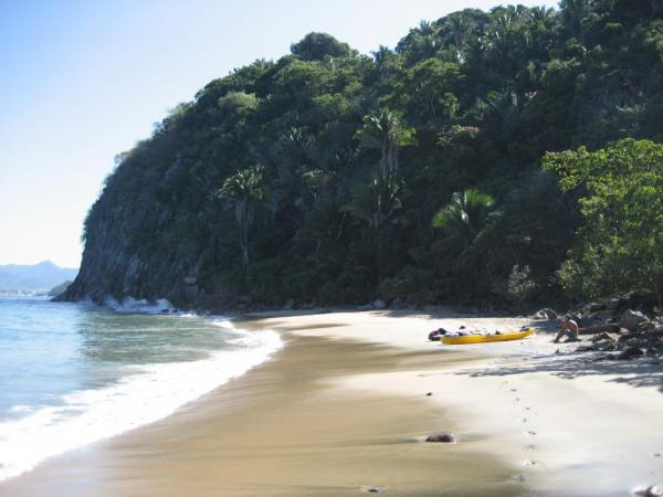 Explore secret beaches on a kayaking excursion from Tailwind Jungle Lodge