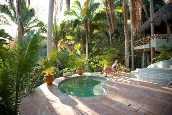 Soak in the tropics next to the pool