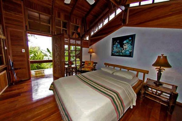 Rooms are nestled in the hillside with spectacular views of the tropical setting