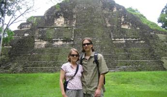Travelers in front of ruins at Tikal