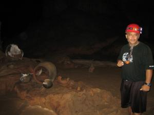 Guide describing Mayan artifacts in ATM cave