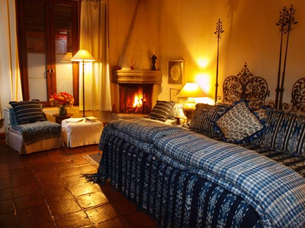 Cozy room with fireplace at Posada del Angel