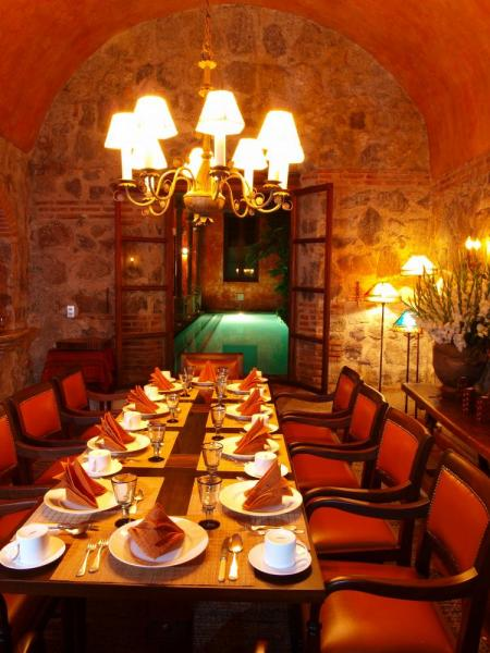 Enjoy meals in the romantic hotel dining room