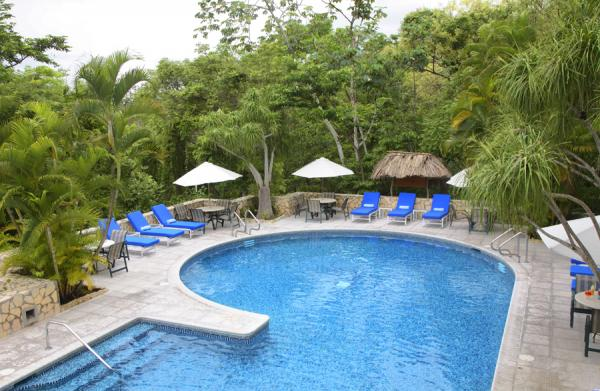 Relax poolside at Camino Real Tikal