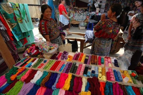 Delightful smiles from vendors at Comalapa Market in Guatemala