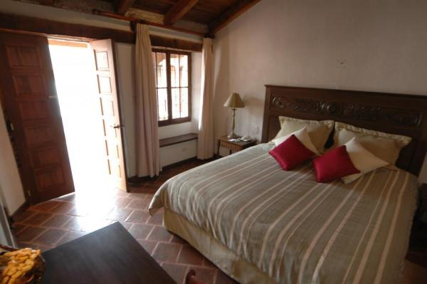 A cozy double room at Meson de Maria