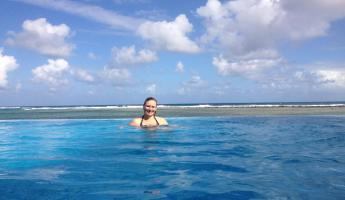 Enjoying a dip in the infinity pool at Turneffe Flats