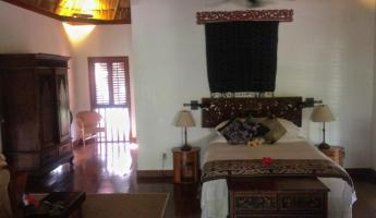 Beautiful Bali-style room at Turtle Inn in Placencia