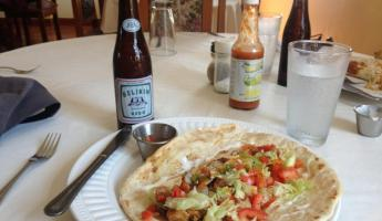 Shrimp fajitas and a cold Belikin for lunch in Placencia