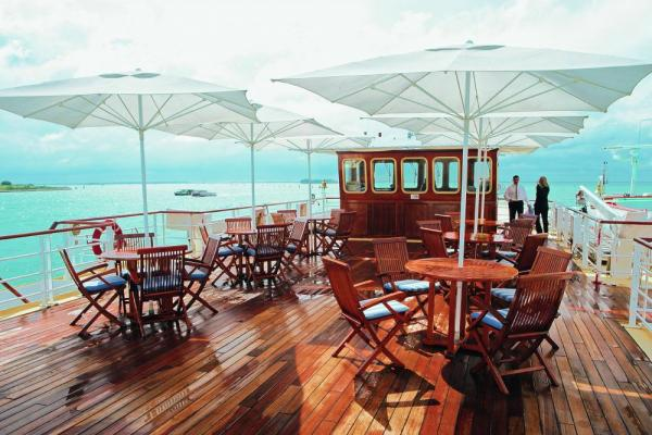 The sun deck offers space to relax, chess, shuffleboard and the Lido bar