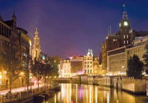 Watch the lights of Amsterdam reflect off the water of the city\s celebrated canals